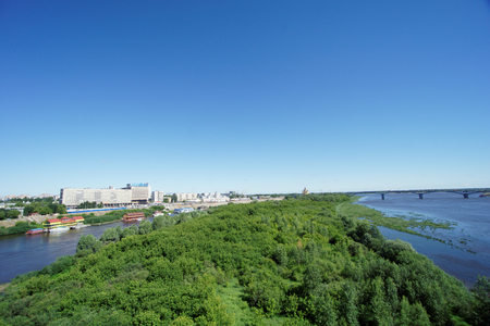 oka: Nizhny Novgorod, Russia. - June 28.2016. View from the metro bridge across the Oka River to the island and a low bank of the river