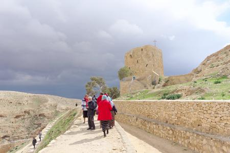 Bethlehem, Israel. - February 14.2017. Pilgrims go to the Lavra of Savva the Sanctified in the Judean Desert Editorial