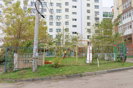 Nizhny Novgorod, Russia. - October 13.2016. Childrens playground is fenced with a fence with a locked gate. Only for the children of the residents of the neighboring house. Editorial