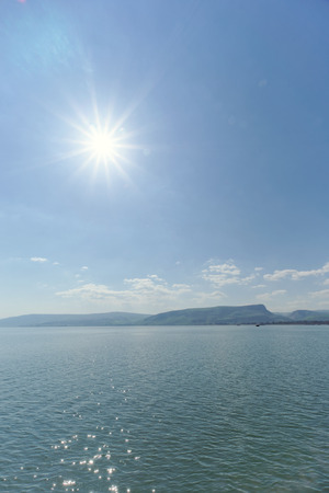 Israel, view of the Sea of Galilee. Bright Sun over the water. Stock Photo
