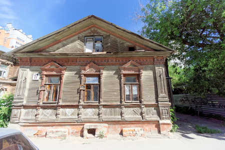 requires: Nizhny Novgorod, Russia. - June 30.2016. Wooden house on the street Nizhegorodskaya.