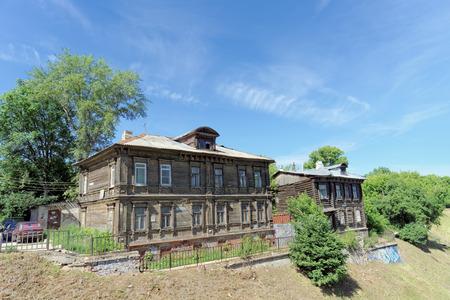 requires: Nizhny Novgorod, Russia. - June 30.2016. Old residential building on Grebeshkovsky escarpment 11. A dilapidated wooden building