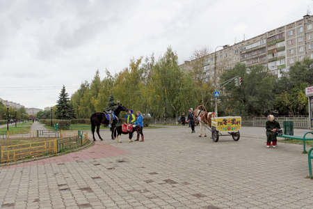 Nizhny Novgorod, Russia. - October 06.2017. Entertainment for the children the opportunity to ride on a pony or a horse-drawn carriage on the prospectus of the 70th anniversary of October