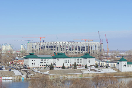 Nizhny Novgorod, Russia. - March 14.2017. Regional administration of the State Traffic Safety Inspectorate on the bank of the river Oka. Behind is the construction of a football stadium for the 2018 World Cup. Éditoriale