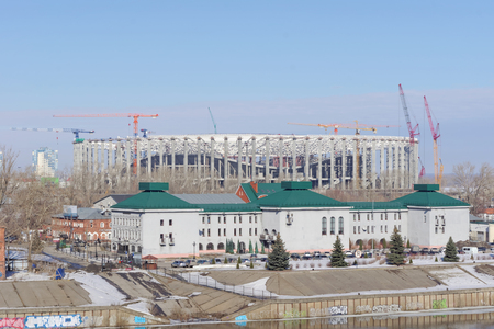 Nizhny Novgorod, Russia. - March 14.2017. Regional administration of the State Traffic Safety Inspectorate on the bank of the river Oka. Behind is the construction of a football stadium for the 2018 World Cup. Editorial