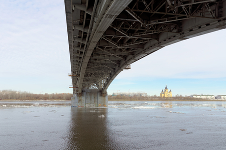 Nizhny Novgorod, Russia. Canavinsky bridge over the river Oka. The ice remains on the cold Oka. Photo taken from under the bridge.
