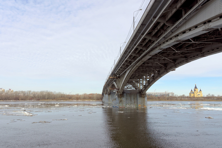 Nizhny Novgorod, Russia. - March 24.2017. Canavinsky bridge over the river Oka. The ice remains on the cold Oka. Photo taken from under the bridge. Stock Photo