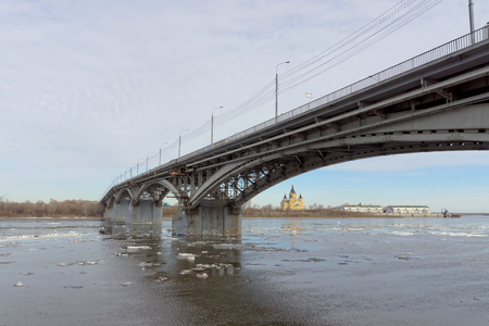 Nizhny Novgorod, Russia. - March 24.2017. Canavinsky bridge over the river Oka. The ice remains on the cold Oka.