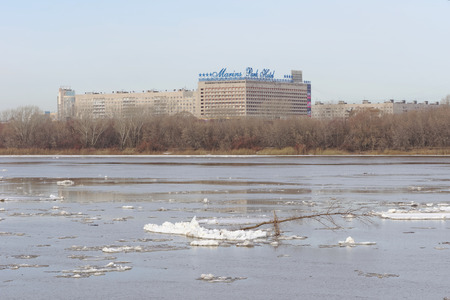 Nizhny Novgorod, Russia. - March 24.2017.View of Marins Park Hotel from the other side of the Oka. The remains of ice floes are floating on the dark water