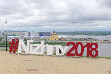 Nizhny Novgorod, Russia. - June 6.2018. View from the high bank of Oka to the new football stadium and the Cathedral of St. Alexander Nevsky. Heshteg Nizhny2018 in the form of a statue on the river ba 報道画像