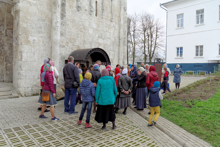 Vladimir, Russia. - May 06.2018 Bogolyubovo-Holy Bogolyubsky Convent. Group of pilgrims with a guide on excursions in the monastery.