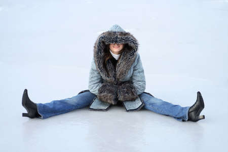 young woman sits on the ice
