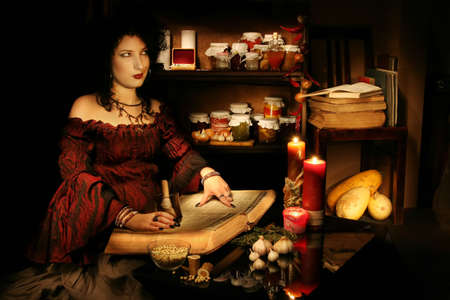 Young witch studies sorcery Stock Photo - 403809