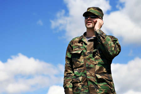 distant work: soldier and cellular phone Stock Photo