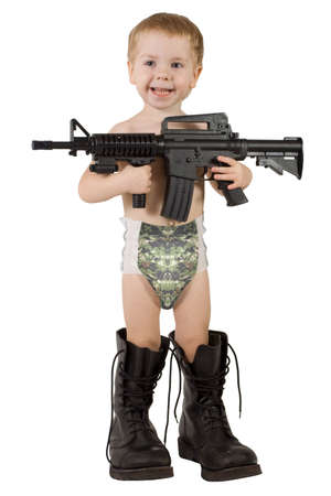 little boy with gun in father's military boots and in camouflage diaper