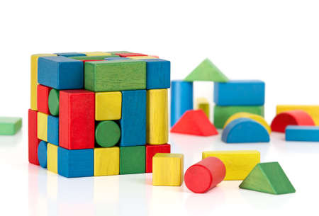 toy blocks jigsaw cube, multicolor puzzle pieces over white