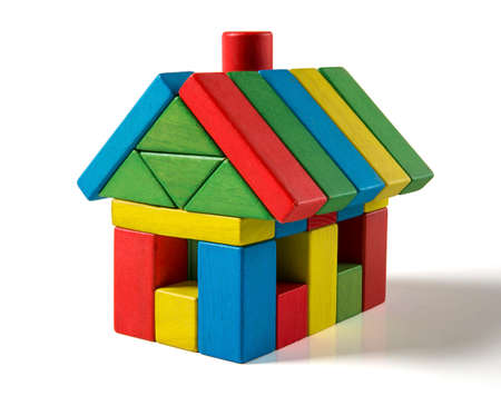 house toy blocks isolated white background, little wooden home Standard-Bild