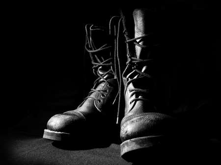 military army boots black background Foto de archivo