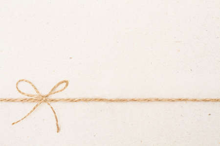 Cardboard Paper Background with Bow Rope, Carton Texture and Vintage Twine Ribbon Knot