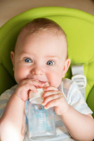 Baby Surprised Face, Funny Infant Kid Rolling Eyes, Amazed Looking Child with Milk Bottle