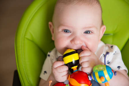 Happy Baby, Cute Infant Kid Playing with Teether Toy, Smiling Boy Portrait, Seven Months Old Stockfoto