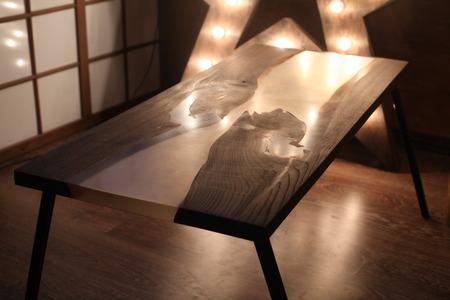 epoxy: Wood and epoxy table with star lamp and metal legs in wooden interior Stock Photo