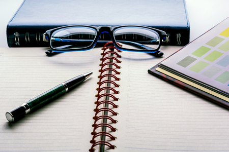 Ebook and diary and glasses on the table