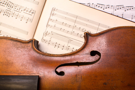 old violin on the lied notes Stock Photo