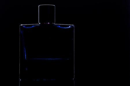 square perfume bottle on black
