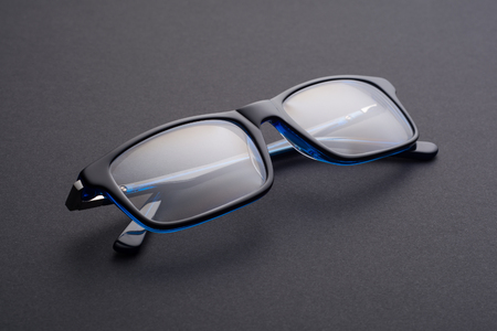 blue glasses on a dark background