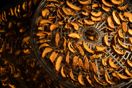 Dried apples on a drying tray with sunlight