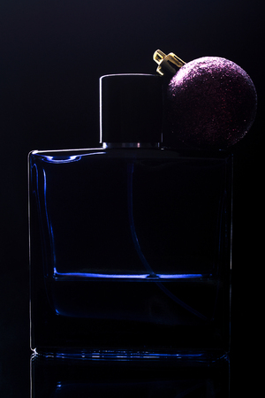 mans perfume on a black background. christmas gift concept