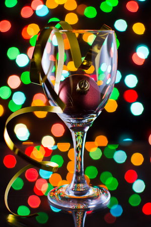 red christmas ball inside a glass