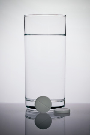 effervescent tablets a glass of water