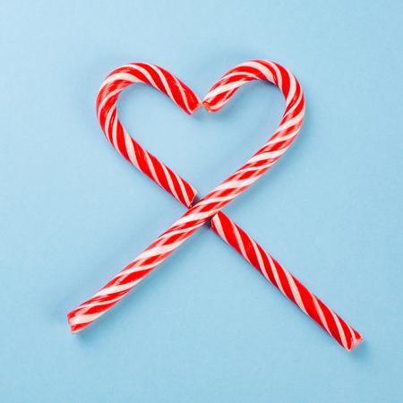 lollipops in the shape of a heart on blue background