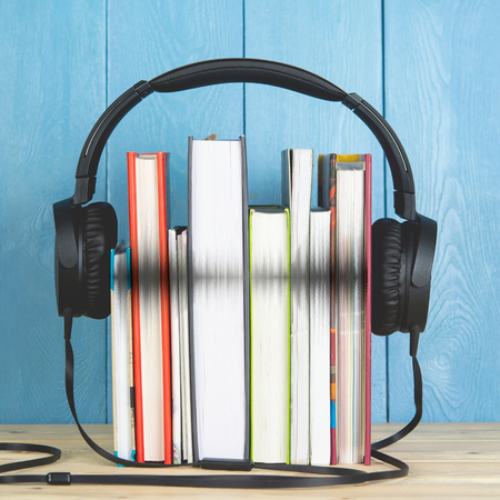 headphone and books on blue background 스톡 콘텐츠