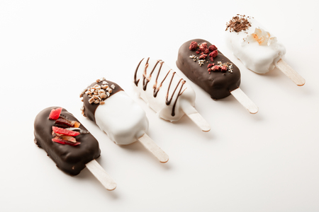Different variants of cake popsice creams arranged diagonally Imagens