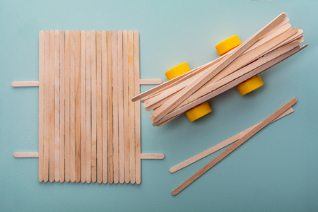 startup concept. toy car with wooden sticks