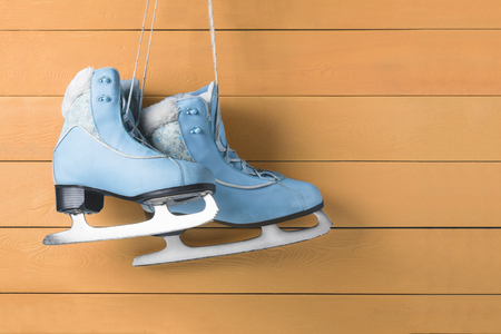 blue women skates on a wooden wall