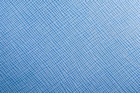 background or texture of blue natural leather closeup