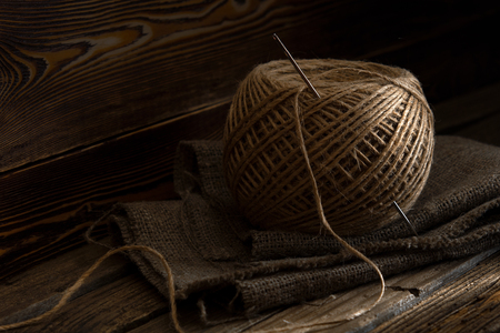 jute skein on an old wooden background