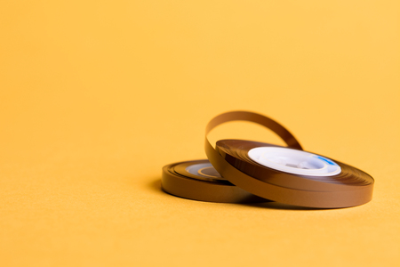 reel of musical tape on yellow background Stock Photo