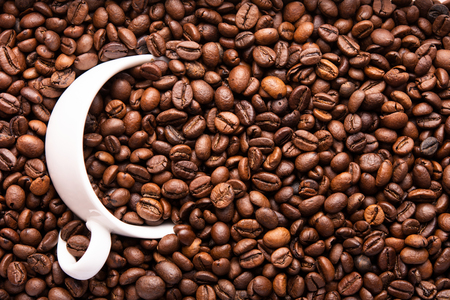 white cup of coffee beans top view