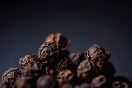 black pepper close-up on a blue background