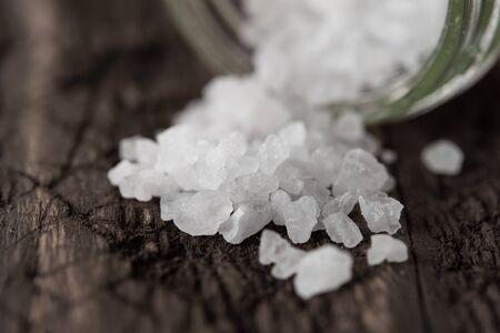 coarse sea salt on a dark wooden background Stock fotó