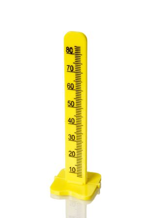Yellow measuring pole on a white isolated background close-up. Yellow ruler or measuring tool.