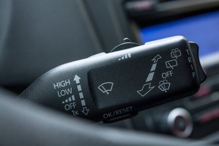 Wipers switch control close up.Wipers control.?djusting speed of screen wipers in car. Wiper control stick