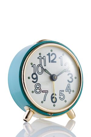 Blue retro alarm clock on a white isolated background, closeup.