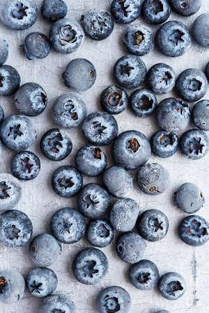 Frozen blueberries on metal surface. Top View 免版税图像