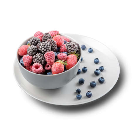 Frozen berries in a gray bowl on a white isolated background. 免版税图像